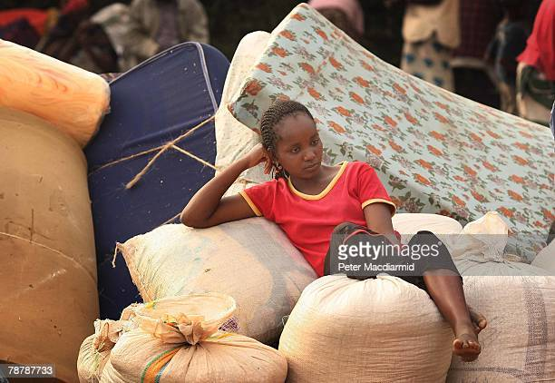 A displaced Kikuyu girl rest on her belongings in the grounds of Eldoret Cathedral on January 5 2008 in Western Kenya These Kikuyu people have been...