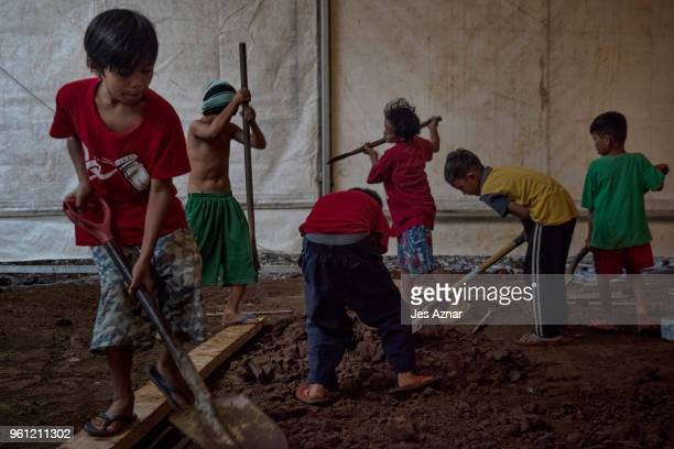 Displaced Marawi children helping build the mosque they will use for prayers during Ramadan that will start in a few days on May 15 2018 in Marawi...