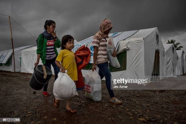 Displaced Marawi city residents with their belongings arrive inside the SArimanok tent city on May 16 2018 in Marawi Philippines With their homes...