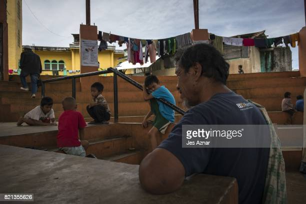 Displaced Marawi inside a makeshift evacuation center on July 23 2017 in Saguiaran Lanao del Sur southern Philippines Thousands of Marawi residents...