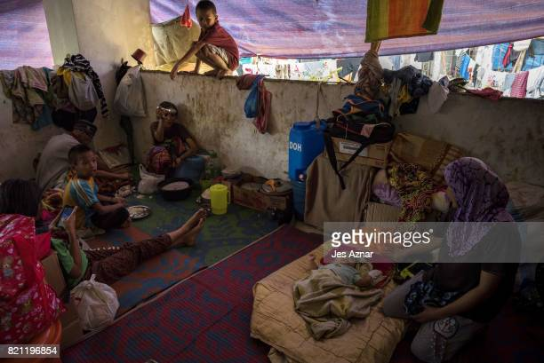 Displaced Marawi residents inside a makeshift evacuation center on July 23 2017 in Saguiaran Lanao del Sur southern Philippines Thousands of Marawi...