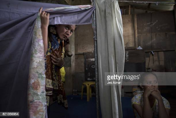 Displaced Marawi residents inside a makeshift evacuation center on July 23 2017 in Baloi Lanao del Norte southern Philippines Thousands of Marawi...