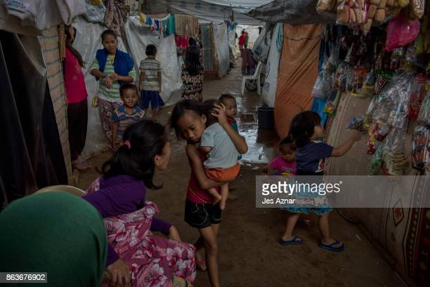 Displaced Marawi residents living inside a makeshift evacuation center on October 18 2017 in Saguiaran town in Lanao del Sur southern Philippines...