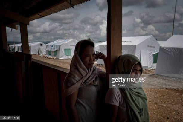 Displaced Marawi residents under a shade inside the Sarimanok tent city on May 14 2018 in Marawi Philippines With their homes destroyed and their...