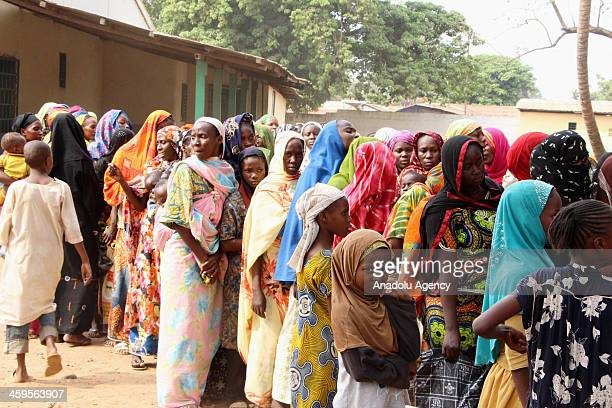 Displaced Muslim women queue for handouts outside the Central Mosque compound in Kilometer 5 muslim suburb in the capital Bangui Central African...