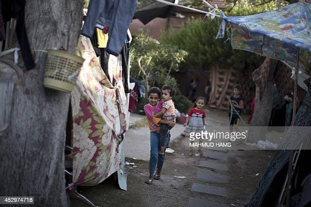 Displaced Palestinian children gather at the al-Shifa hospital in Gaza City where they have taken refuge after fleeing attacks in the Shejaiya...
