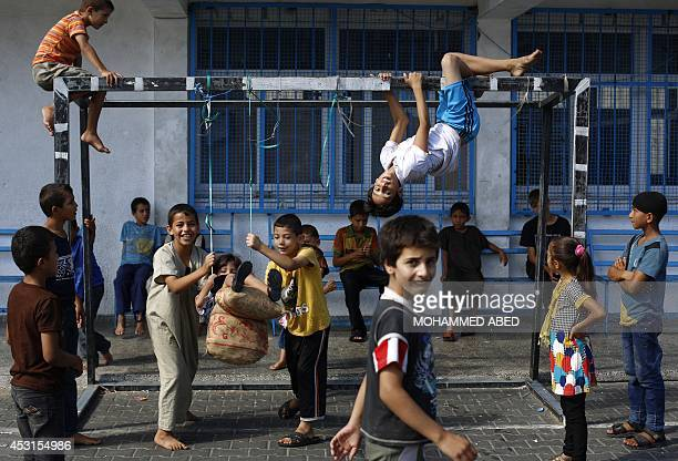 Displaced Palestinians play at a United Nations school in Beit Lahia in the northern Gaza Strip on August 4 where they are taking refuge after...