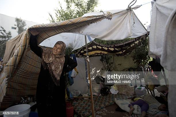 Displaced Palestinians take shelter at the al-Shifa hospital in Gaza City after fleeing attacks in the Shejaiya neighbourhood of the city, on July...