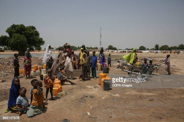 Displaced people collect water in Muna Garage IDP camp More than two million were displaced during the conflict with Boko Haram