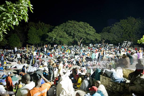 Displaced people gather on Place Boyer in PetionVille to spend the night following a major earthquake on January 13 2010 in PortauPrince Haiti A 70...
