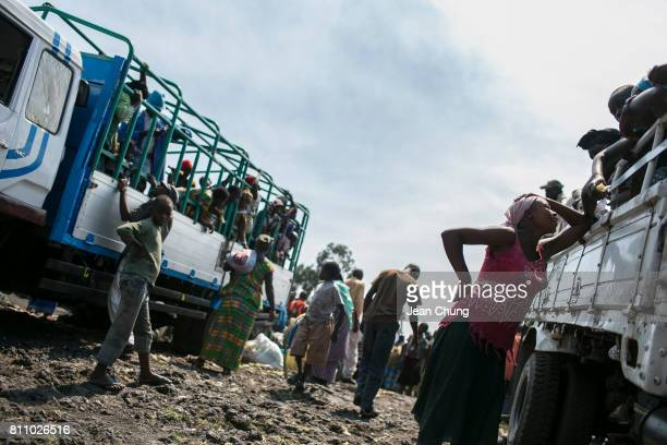Displaced people in Mugunga I say the final farewells before the truck takes them back to their home villages on June 24 2014 in Goma Democratic...