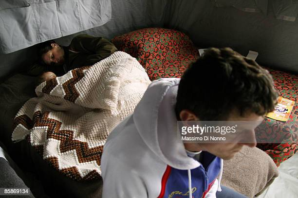 Displaced people live in a temporary shelter camp after an earthquake hit the region on April 8, 2009 in L' Aquila, Italy. The 6.3 magnitude...
