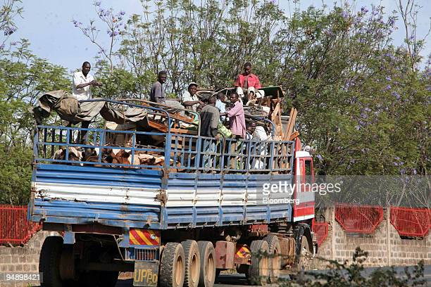 Displaced people ride in a truck with their belongings in Eldoret Kenya on Saturday Feb 16 2008 As many as 400 people died in the violence in and...