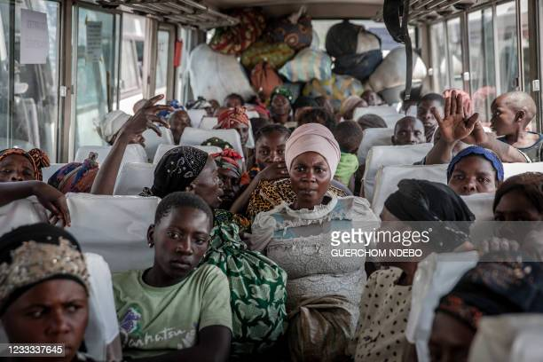 Displaced people who fled Goma after the eruption of the Nyiragongo volcano wait on a bus in Sake with their belongings, waiting to be taken home on...