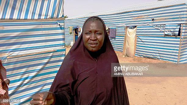 Displaced person Aisha Bala speaks outside her tent about lack of adequate food in the Dalori Internally Displaced People's Camp for people displaced...