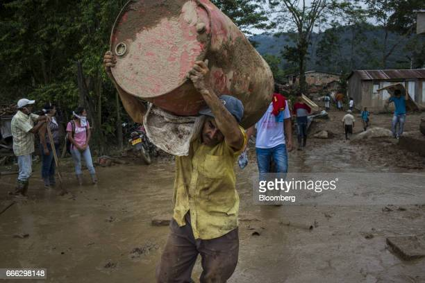 Displaced resident move debris as water continues to flow after a landslide in the San Miguel neighborhood of Mocoa Putumayo Colombia on Monday April...