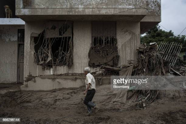 A displaced resident walks through debris in front of destroyed home in the San Miguel neighborhood of Mocoa Putumayo Colombia on Monday April 3 2017...