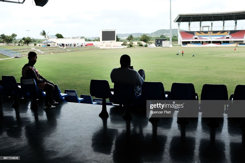 Displaced residents from the island of Barbuda sit inside a shelter at a cricket stadium on December 7, 2017 in St John's, Antiqua. Barbuda, which covers only 62 square miles, was nearly leveled when Hurricane Irma made landfall with 185mph winds on the night of September 6. Only two days later, fearing Barbuda would be hit again by Hurricane Jose, the prime minister ordered an evacuation of all 1,800 residents of the island. Most are now still in shelters scattered around Barbuda's much larger sister island Antigua.