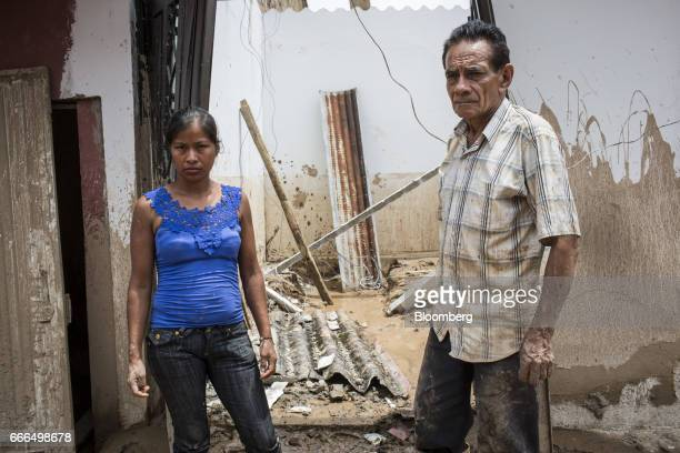 Displaced residents stand outside their destoryed home in the Prospero neighborhood of Mocoa Putumayo Colombia on Monday April 3 2017 Torrential...