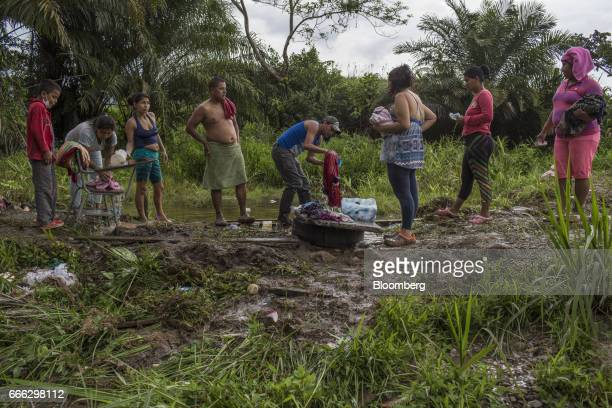 Displaced residents wash clothes in a small pond after a landslide in the Miraflores neighborhood of Mocoa Putumayo Colombia on Monday April 3 2017...