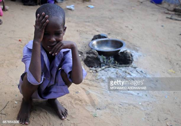 TOPSHOT A displaced Somali child sits on May 24 2017 at a makeshift camp in the Garasbaley area on the outskirts of the capital Mogadishu where...