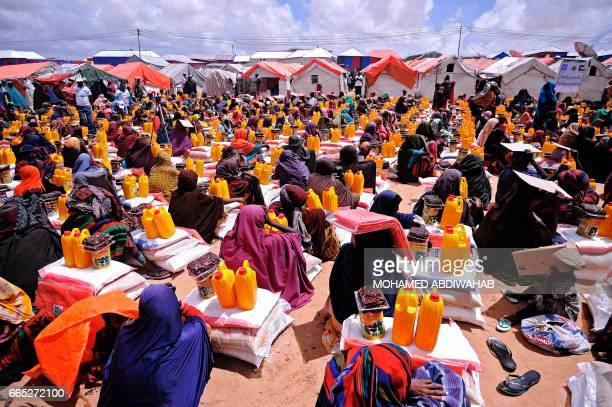 Displaced Somalis wait for food aid at a distribution centre outside Mogadishu on April 6 2017 Hundreds of new arrivals mostly from the hardest hit...