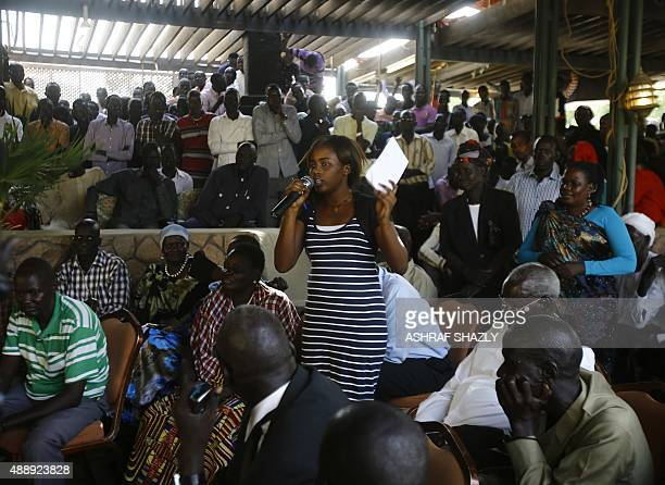 Displaced Sudanese people who fled South Sudan attend a meeting with South Sudan's former Vice President and rebel leader Riek Machar in the Sudanese...