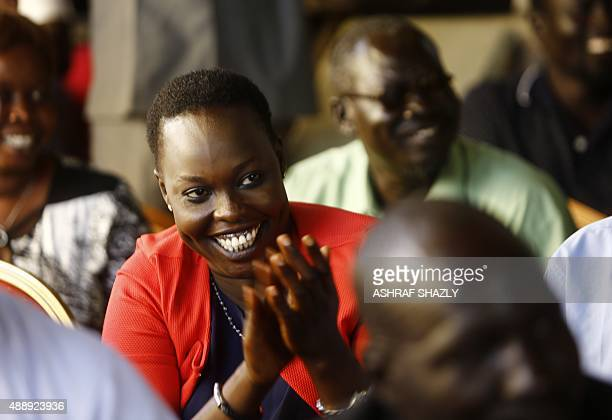 Displaced Sudanese woman who fled South Sudan claps during a meeting with South Sudan's former Vice President and rebel leader Riek Machar in the...
