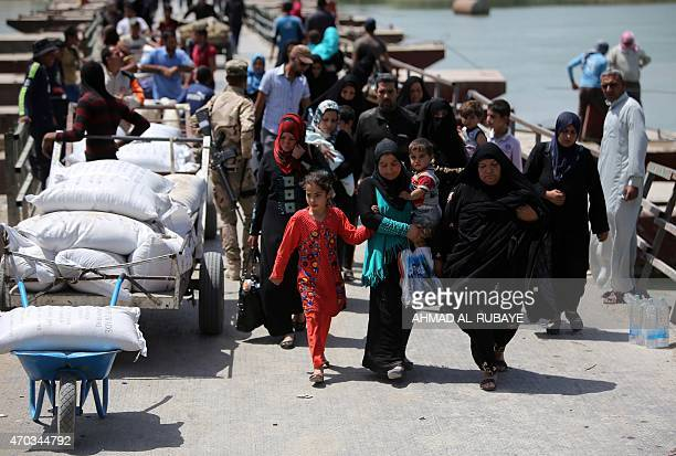 Displaced Sunni Iraqis who fled the violence in the Iraqi city of Ramadi arrive at the outskirts of Baghdad on April 19 2015 More than 90000 people...