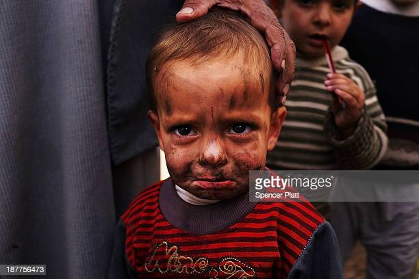 A displaced Syrian child is viewed in a makeshift camp for Syrian refugees only miles from the border with Syria in the Bekaa Valley on November 12...