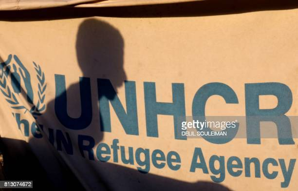 Displaced Syrian child, who fled the countryside surrounding the Islamic State group's Syrian stronghold of Raqa, is seen silhouetted on a UNHCR tent...