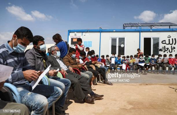 Displaced Syrian children and their parents attend a workshop organised by medical volunteer affiliated with a Turkish-registered Syrian relief...