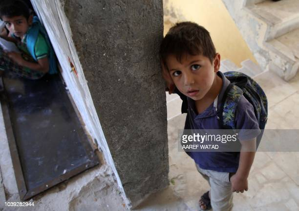 Displaced Syrian children attend class at a makeshift school in the village of Muhandiseen in the south western countryside of the Aleppo province on...
