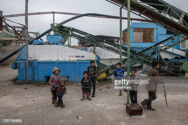 Displaced Syrian children play at a olive oil factory turned into a makeshift refugee shelter on February 21 2020 in Idlib Syria Turkey's President...