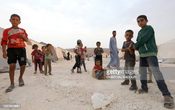 Displaced Syrian children play in the camp 'Hope' in the Syrian village of Kafr Lusein north of the Bab alHawa border crossing on September 13 2018