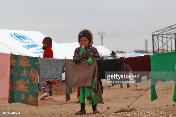 TOPSHOT Displaced Syrian children stand at the Internally Displaced Persons camp of alHol in alHasakeh governorate in northeastern Syria on December...