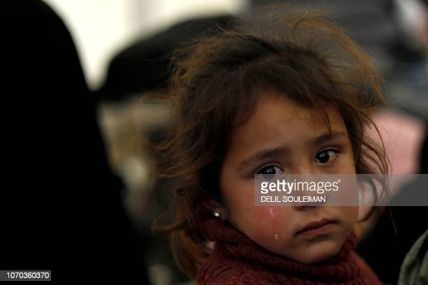 Displaced Syrian girl cries inside the Internallly Displaced Persons camp of al-Hol in al-Hasakeh governorate in northeastern Syria on December 8,...