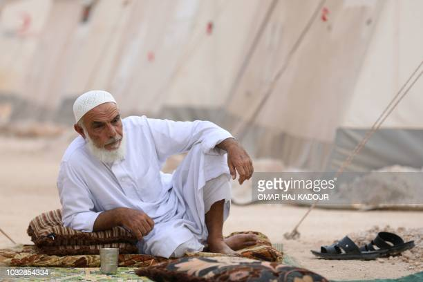 A displaced syrian man looks on in the camp 'Hope' in the Syrian village of Kafr Lusein north of the Bab alHawa border crossing on September 13 2018