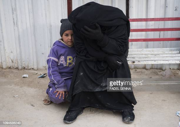 TOPSHOT A displaced Syrian woman and a child are pictured at the Internally Displaced Persons camp of alHol in alHasakeh governorate in northeastern...