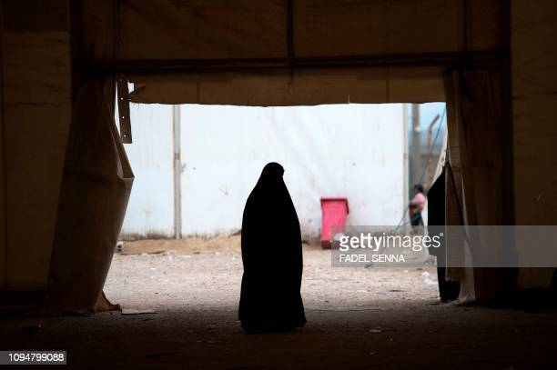 TOPSHOT A displaced Syrian woman stands at the Internally Displaced Persons camp of alHol the northeastern Syrian alHasakeh governorate on February 6...