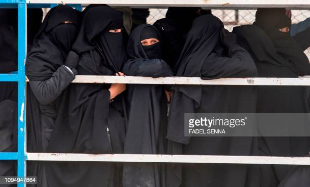 Displaced Syrian women queue at the Internally Displaced Persons camp of alHol in alHasakeh governorate in northeastern Syria on February 7 2019