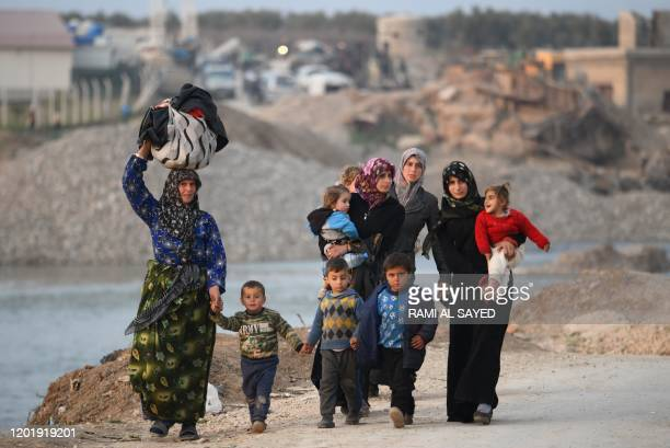 Displaced Syrians arrive to Deir alBallut camp in Afrin's countryside along the border with Turkey on February 19 2020