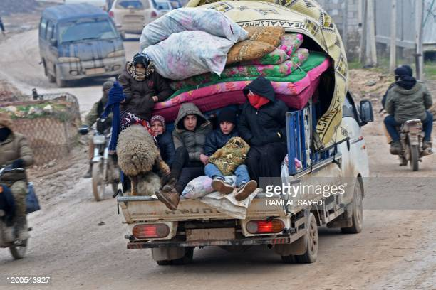 Displaced Syrians flee the countryside of Aleppo and Idlib provinces towards Syria's northwestern Afrin district near the border with Turkey on...