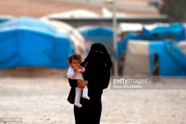 TOPSHOT Displaced Syrians from the eastern city of Deir Ezzor and Raqa who were forced to leave by the war against the Islamic State group are...