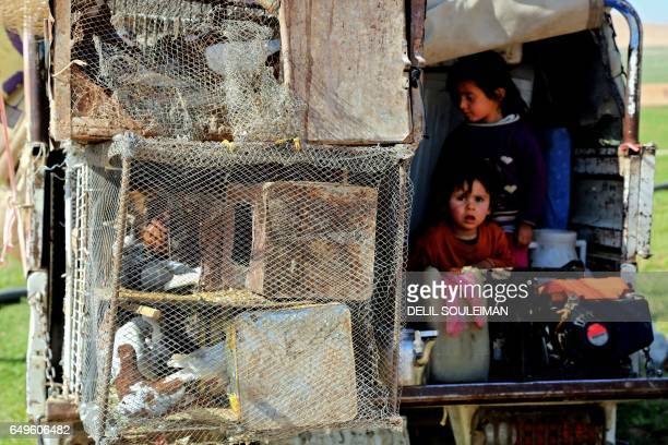 TOPSHOT Displaced Syrians gather at a makeshift camp for displaced people near the northern town of Manbij on March 8 2017 as the number of people...