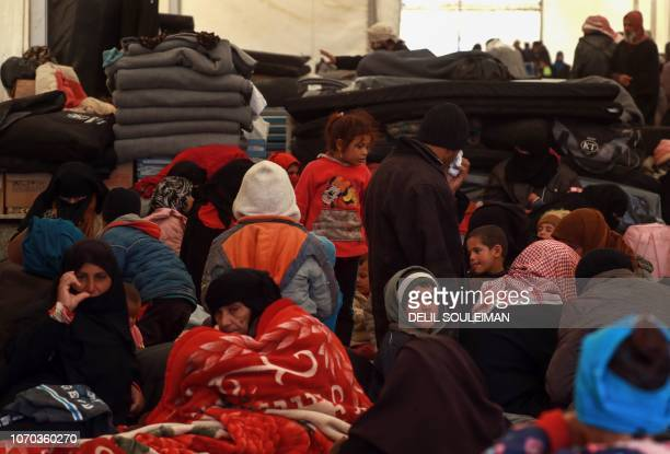 Displaced Syrians gather inside a tent in the Internallly Displaced Persons camp of alHol in alHasakeh governorate in northeastern Syria on December...