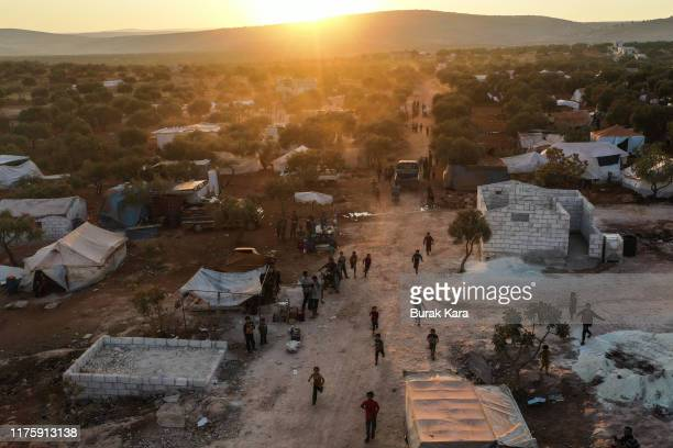 Displaced Syrians, mostly from north Syria, live in tents at a squatter camp on the outskirts of Killi village on September 18, 2019 in Idlib, Syria....
