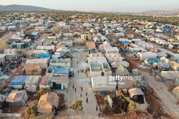 Displaced Syrians mostly from north Syria live in tents at a squatter camp on the outskirts of Killi village on September 18 2019 in Idlib Syria...