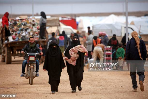 Displaced Syrians who fled their homes in Deir Ezzor city are seen at a refugee camp in Syrias northeastern Hassakeh province on February 26 2018 /...