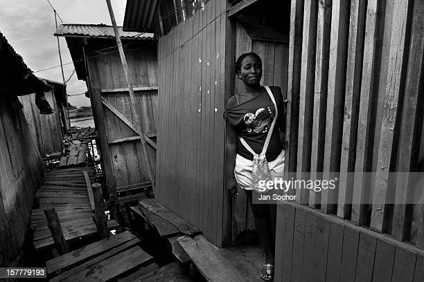 Displaced woman lives in a wooden house in the stilt house area in Tumaco, Nariño dept., Colombia, 11 June 2010. With nearly fifty years of armed...